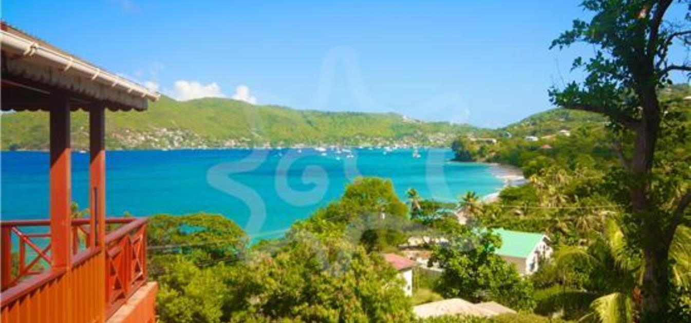 vacation-rentals/st-vincent-and-the-grenadines/bequia/lower-bay/sweet-retreat-hotel-yellow-room-2
