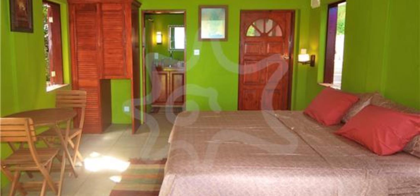 vacation-rentals/st-vincent-and-the-grenadines/bequia/lower-bay/sweet-retreat-hotel-yellow-room-1